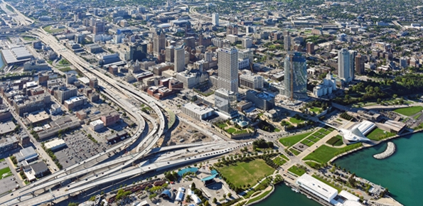 A photo of an aerial view of downtown Milwaukee and Lake Michigan.